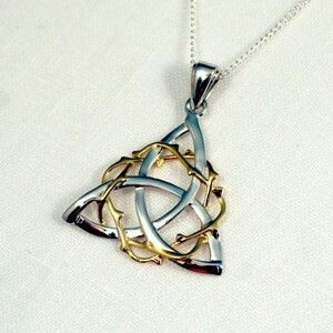 Celtic Crown of Thorns around the Celtic Trinity Knot. Radial in balence type of the actuql piece of jewelry