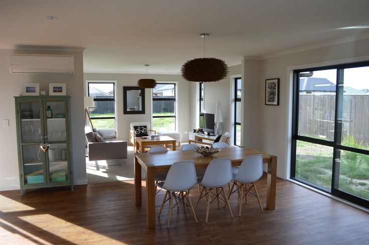 This open plan living is light and breezy with plenty of glass that can be opened up to add fresh air.