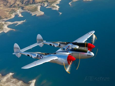 A Lockheed P-38 Lightning Fighter Aircraft in Flight Photographic Print by Stocktrek Images at AllPosters.com