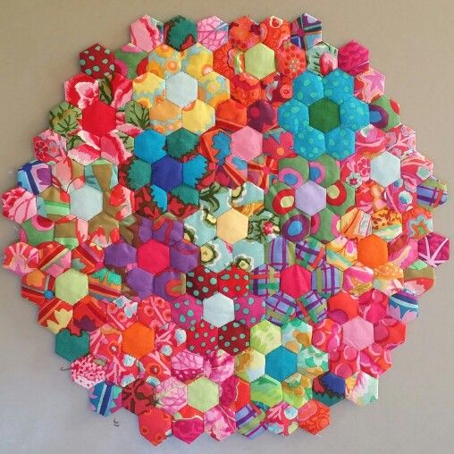 Tiny hexies with scrap Kaffe Fassett