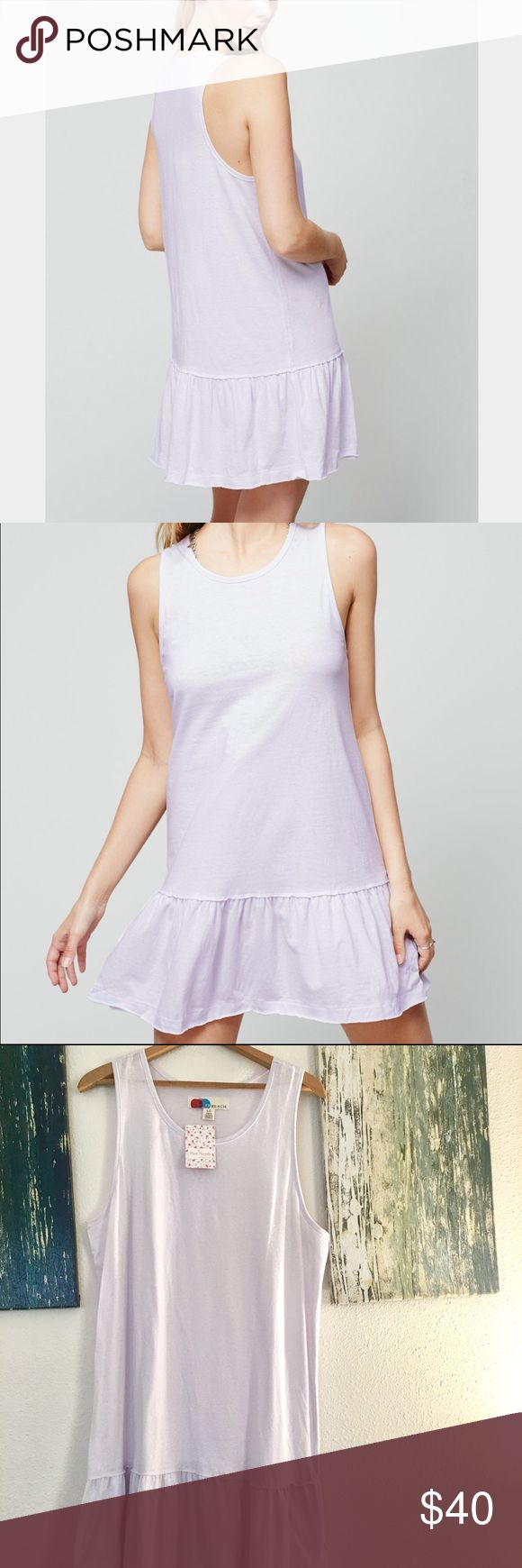 "Free People FB Brittany Peplum Dress Free People Brittany Peplum FP Beach Dress- new with tags- 100% cotton-figure skimming jersey-drop waist silhouette with a flounced skirt- the color is called ""purple""-but in my opinion it's a VERY light lavender- raw edges all over- unlined- perfect over a bathing suite or dress it up with heals and accessories for date night! Free People Dresses Midi"
