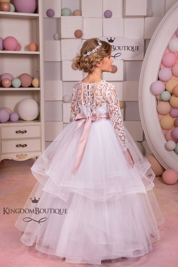 Please read our store policies before placing your order here https://www.etsy.com/ru/shop/Butterflydressua/policy Gorgeous white flower girl dress with multilayered skirt, lace corset with long lace sleeves, buttons, zipper and satin stripe with bow. Item material: upper layer of
