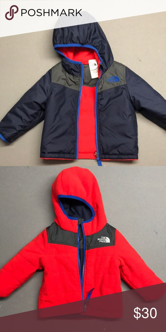 Reversible North Face Jacket Infant 6-12 month reversible North Face jacket. Only worn a few times. The red side is fleece and the navy side is wind/rain resistant material. North Face Jackets & Coats