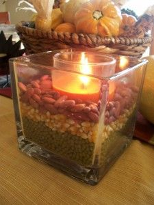 Use different colored beans & candles for fall decorating - I used black eye peas, green lentils and kidney beans in multiple different shaped vases and bottles. Some I put candles and others I did not. So cute and classy! Adds great color and texture to the home. Enjoy! - Roni