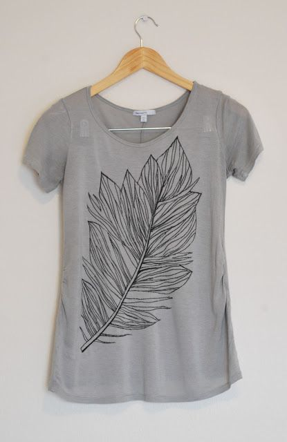 DIY feather made with cardboard for in-between shirt and sharpie markers. She pulled fabric away from pen as she drew for straighter lines. Lovely T-shirt tutorial.