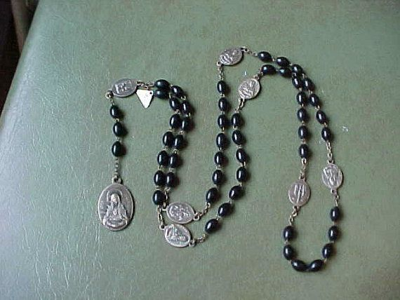 Vintage 7 Sorrows of Mary Chaplet Rosary black by TowerOfIvory, $99.99 https://www.etsy.com/listing/179254651/vintage-7-sorrows-of-mary-chaplet-rosary?