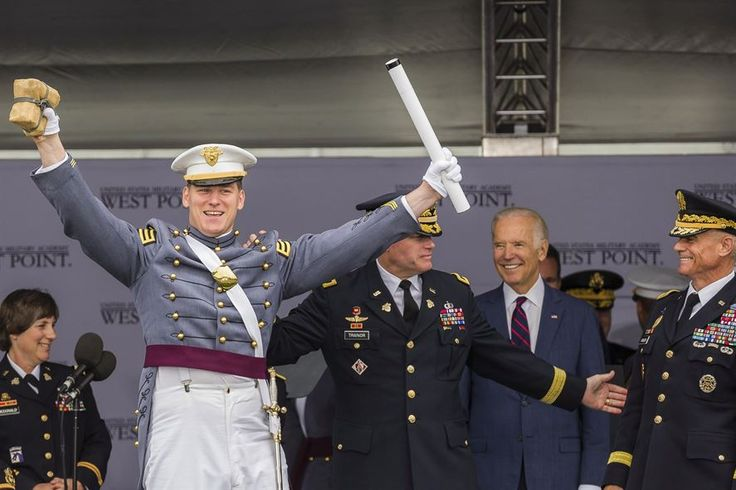Vice President Joe Biden smiles as Army Cadet Alex Fletcher celebrates being named the Goat of the U.S. Military Academy's Class of 2016, in West Point, N.Y., May 21, 2016. The Goat is the last-ranking cadet to graduate and usually receives the loudest applause from the class. Biden delivered the speech at the academy's commencement ceremony. Army photo by Staff Sgt. Vito T. Bryant