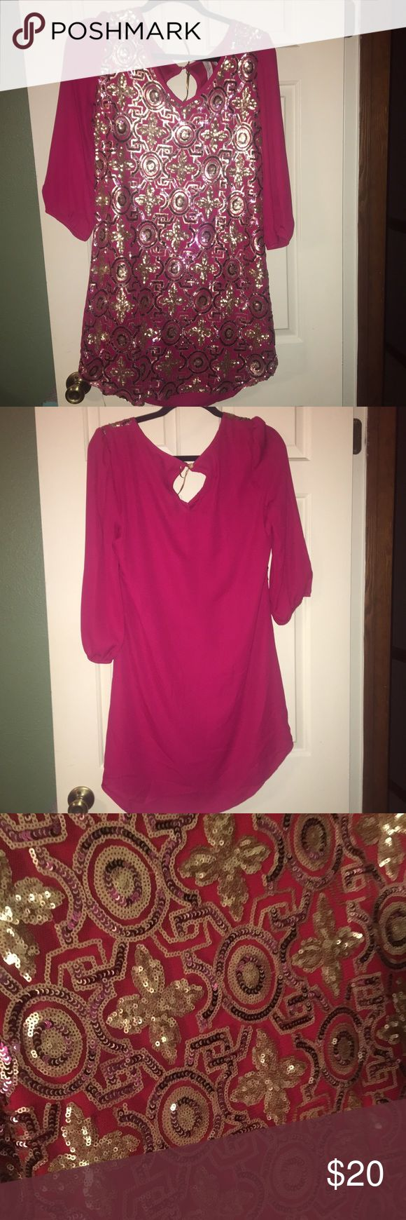 Boutique style wine colored dress This is a beautiful boutique style dress. It is a wine/burgundy color with a gorgeous gold design on the front. Only worn once. Pink Owl Dresses