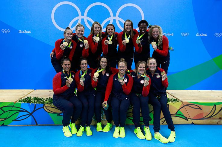 Gold medalists Team United States celebrate on the podium during the medal ceremony for the Women's Water Polo Gold Medal match between the United States and Italy on Day 14 of the Rio 2016 Olympic Games at the Olympic Aquatics Stadium on August 19, 2016 in Rio de Janeiro, Brazil.