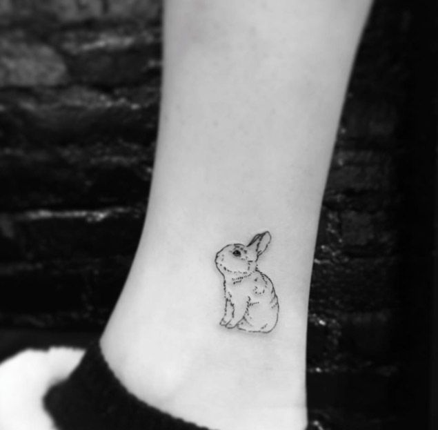 Minimalistic Rabbit Tattoo by Evan Tattoo