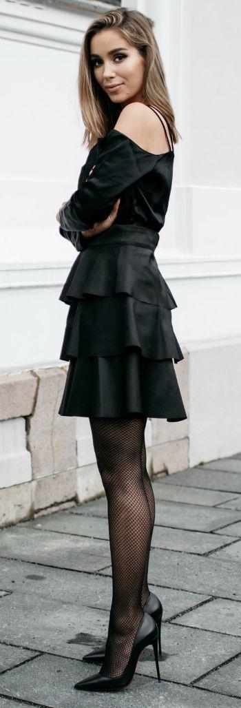 Emilie Tømmerberg + sleek all black + daring tiered off the shoulder dress + fishnets + stilettos + dark and sexy style.   Dress: Gina Tricot.
