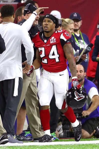 Devonta Freeman of the Atlanta Falcons celebrates after scoring a touchdown against the New England Patriots during the second quarter of Super Bowl...