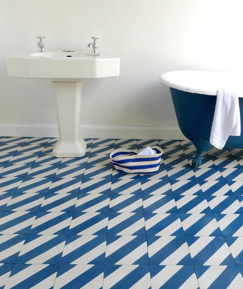 These Popham blue and white tiles are a great way to spruce up the bathroom. So cute. Would they make a chevron pattern when laid if you turned every other one?