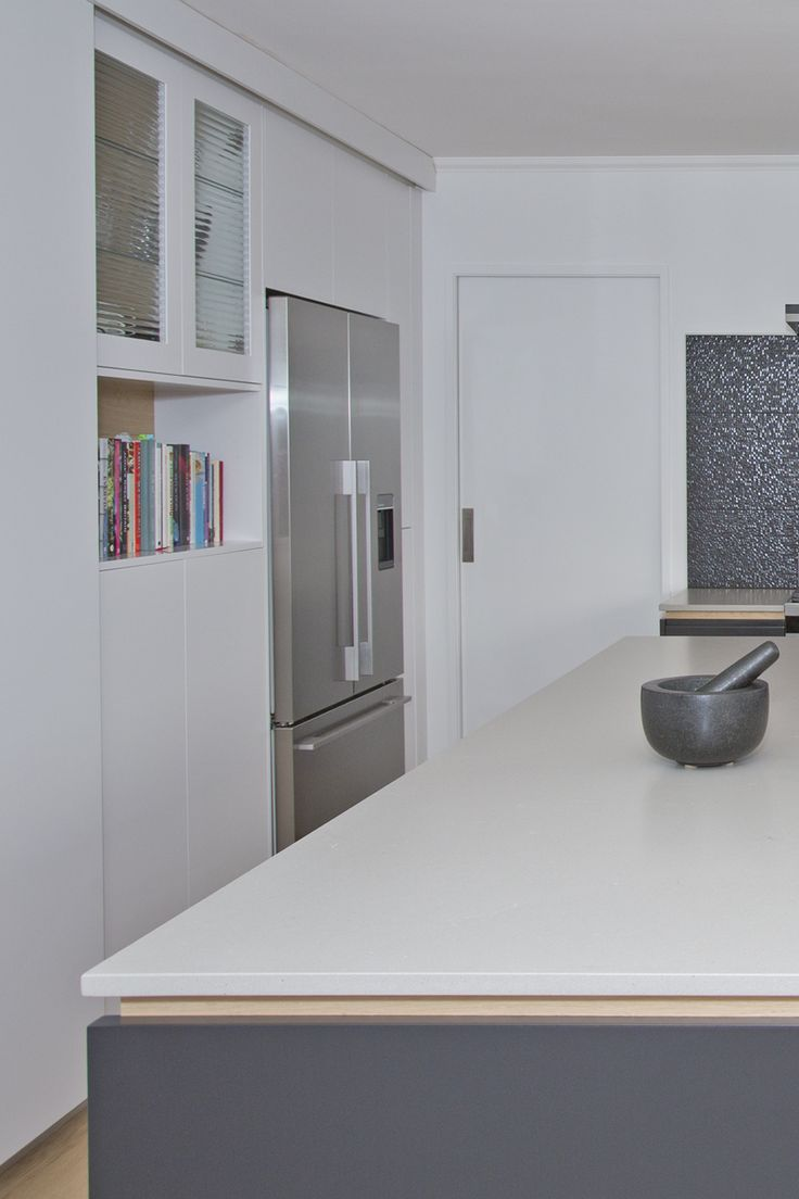 "Sally Steer Design Wellington, New Zealand. Caesarstone ""Raw Concrete"" with Oak negative detail. Resene ""Nero"" & ""Half Black White""."