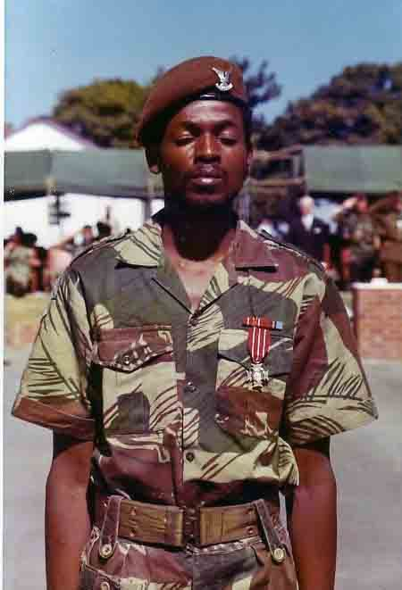 Obert Mabaleka Ndlovu. Selous Scout. Photographic proof the Selous Scouts were an integrated unit, unlike the rest of the Rhodesian military. Also, I believe that's a Bronze Cross on his chest.