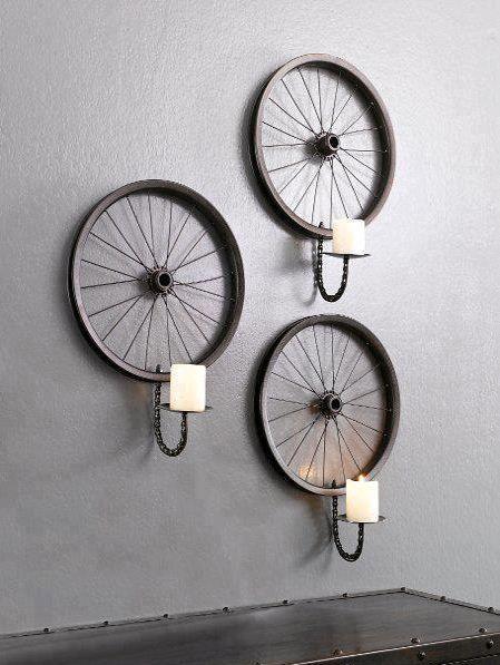 Rodas de bike quebradas podem ser usadas na decoração e como castiçais