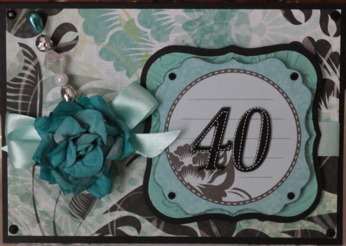40th Birthday Card. Black, teal and white. Embellished with a beautiful flower, satin ribbon and handmade stick pin.