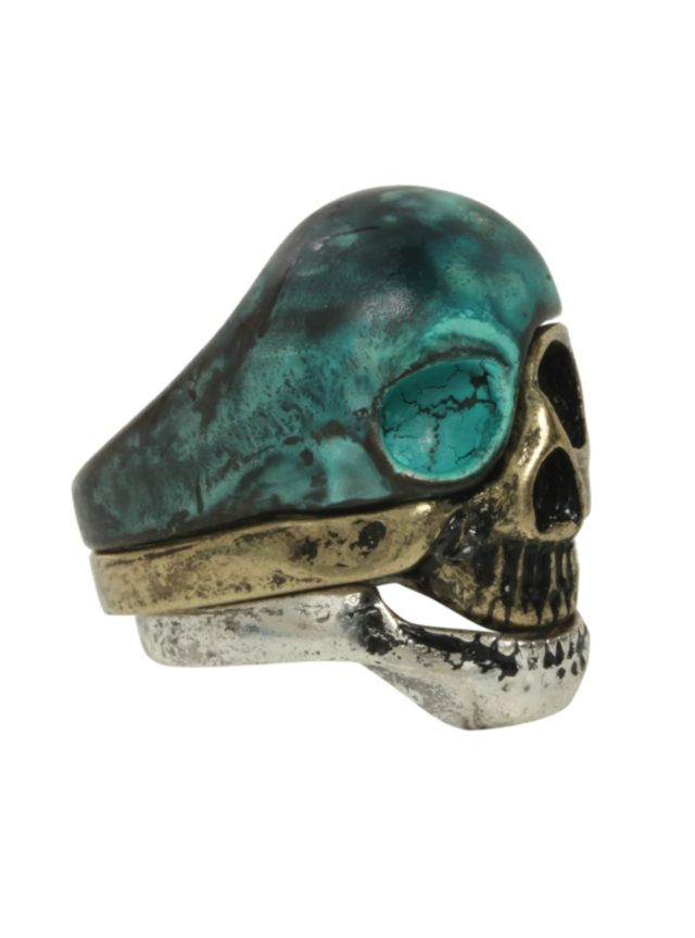 Set of three mixed metal rings that connect to make a skull. OMG YES