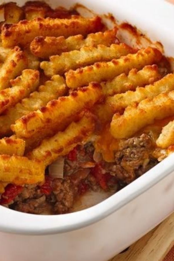 No need to go out for burgers and fries—or to shell out all that money! Put them together right at home in this comforting, affordable casserole. All you need is six ingredients and 45 minutes, and you've got cheesy burgers and fries for the whole family. Pro tip: Be sure to drain the ground beef really well. Extra juices will result in a sad, soggy casserole!