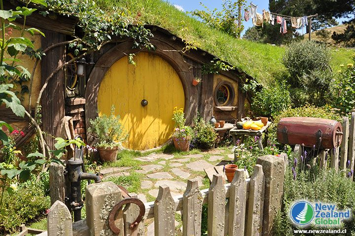 Yellow door of a hobbit hole - Hobbiton, New Zealand