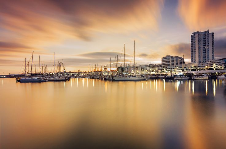 Story behind timelapse image, composite of Ponta Delgada's marina in golden hour and twilight atmosphere.