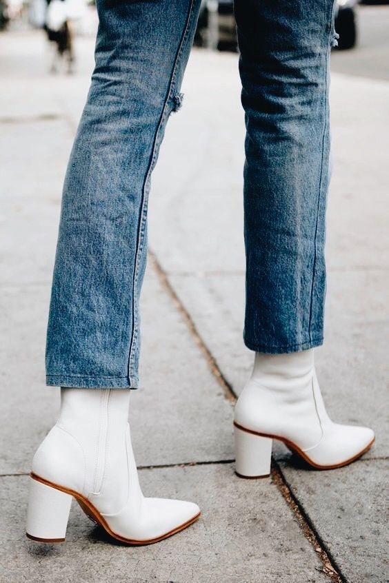 The white boot trend is the latest output in a long line of brave fashion,  and unsurprisingly, it's yet another Céline-inspired style.
