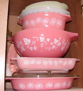 Vintage pink pyrex bowls/dishes.  My mother has these.  I have tried to steal them many, many times.