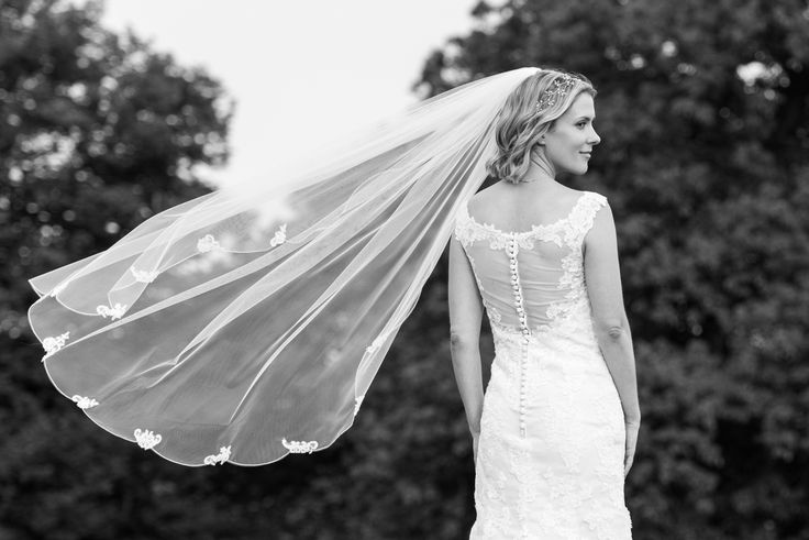 Photo of bride in the Chilham castle estate, Kent. Bride veil shot. Photo by Mugshot Photography