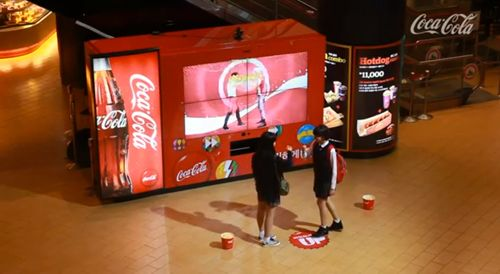 "Coca-Cola has created various innovative vending machines for their ""Happiness"" campaign around the world. In Korea they have now created a huge interactive dancing vending machine that rewards people who complete tasks with free drinks. The harder the challenge the more free coke people got."