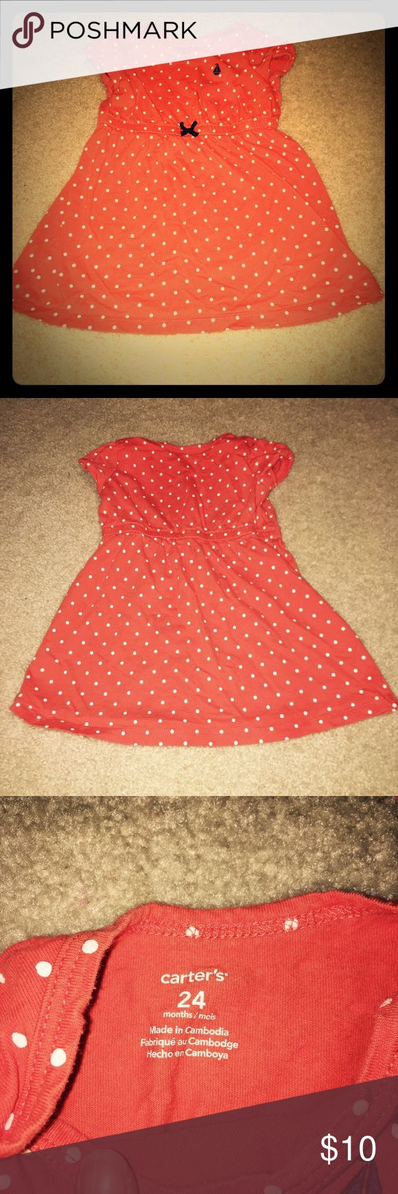 Carter's Polka Dot Orange Short Sleeve Dress This Carter's orange Polka Dot dress is in EUC. It features a elastic waist, shirt sleeve, small bow in the front and a sailboat on the left upper chest. 100% cotton Carter's Dresses Casual