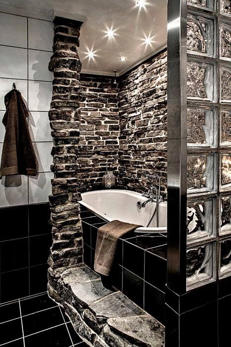 I love the dark stone! I'd want the tub a bit more in the open, with softer, adjustable lighting..