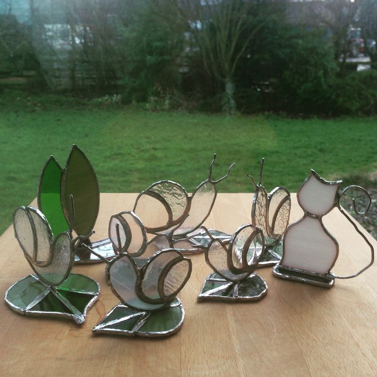 Stained glass snails trees and a cat .. standing up in copper foil