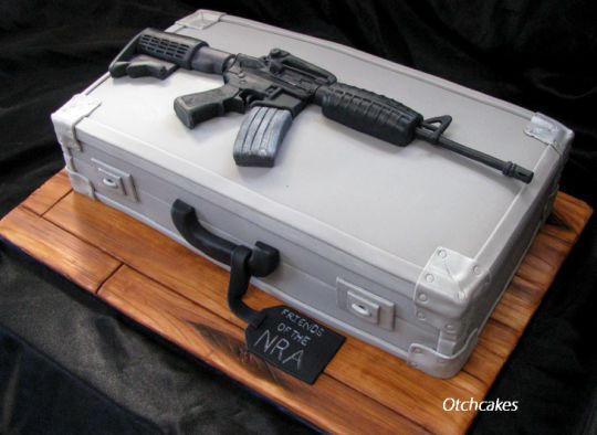 AR-15 Rifle and Gun Case Cake - The rifle is sculpted out of fondant, the cake board is covered in fondant and painted to look like wood, and the gun case is cake covered in fondant. :)