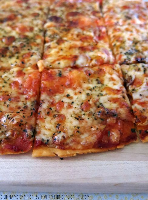 St. Louis-style pizza----a super thin crust topped with pizza sauce, provel cheese and Italian seasoning. Perfecto!