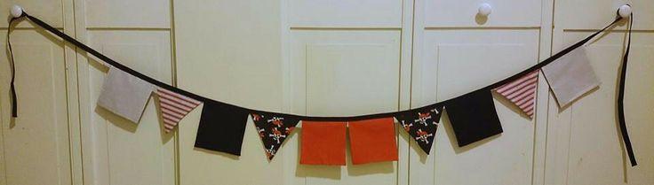 Arrrrr matey! Here be a daft pirate bunting banner. $20+shipping http://www.facebook.com/littledragonbabyboutique