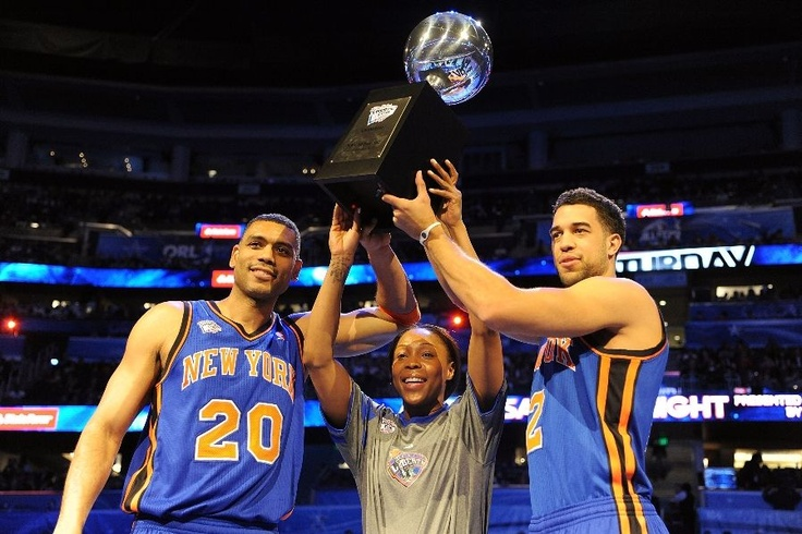 Allan Houston of Team New York, Cappie Pondexter of the New York Liberty and Team New York and Landry Fields of the New York Knicks and Team New York celebrate with the trophy after they won the Haier Shooting Stars Competition part of 2012 NBA All-Star Weekend at Amway Center on February 25, 2012 in Orlando, Florida. (Photo by Mike Ehrmann/Getty Images)