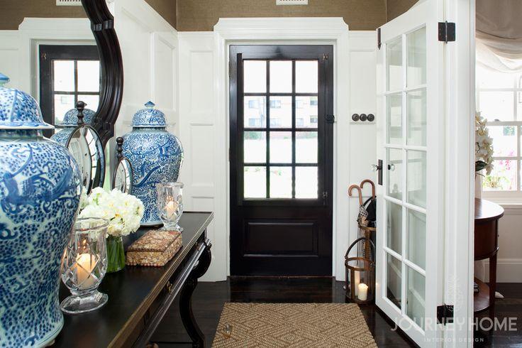 entry, black door, wall paneling, grasscloth wallpaper