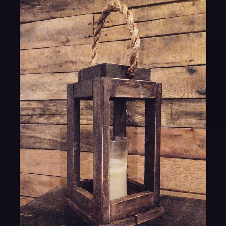 Decorative Rustic Reclaimed Wood Candle Holder Lantern. Looks Great with Rustic or Country decor. Kona and gray stain is pictured. Lantern also available in American Walnut, Driftwood(which is great for a beachy look) or weathered gray!  The Lantern measures at 14in X 7.75in X 7in. Great for wedding centerpieces! Bulk pricing now available!  Great gift for Mothers Day