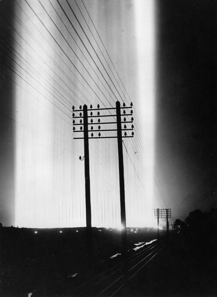 """Speer's """"Cathedral Of Light"""" Shines Above The Distant 1937 Nazi Nuremberg Rally."""