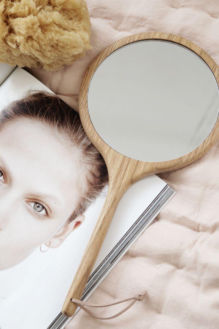 Hand mirror in Oak, beautiful nude bench pad.