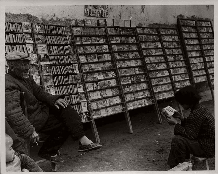 An old man in charge of a portable outdoor library of comics for the kids. Almost without exception these comics are humorless and political. They preach a hatred for the United States and Japanese imperialism, seek to inculcate love for Mao Tse-tung and provide – Vintage: B&W photos of Life in China (1965)