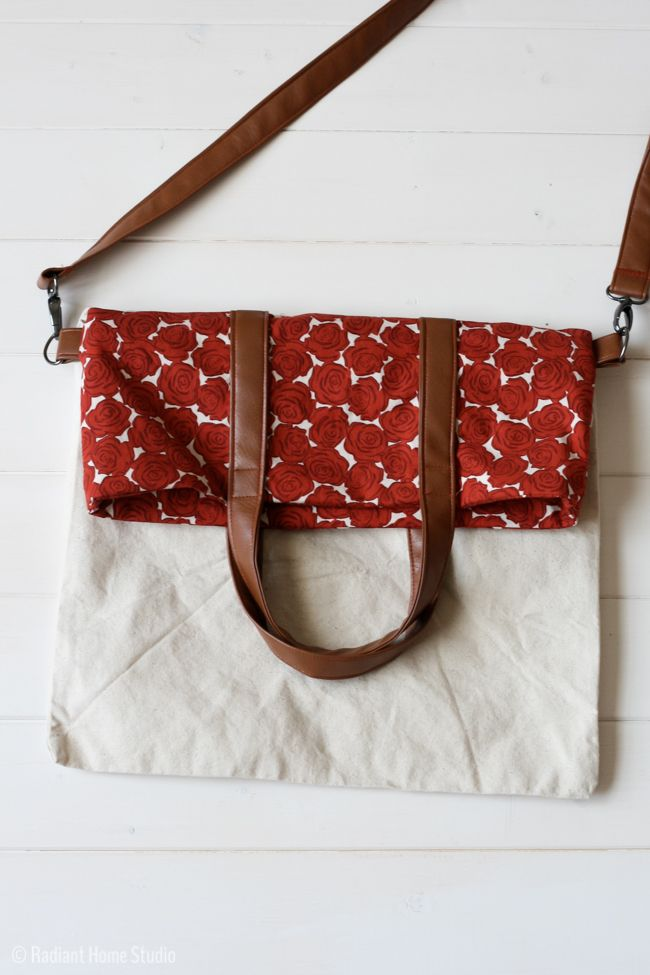 Upgrade a plain tote bag using this fold over tote tutorial. A canvas bag can be totally transformed with some faux leather, modern fabric, and hardware.