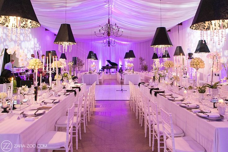 Wedding Reception Decor at Nooitgedacht Estate. Purple uplight,white draping, black lampshades over the long tables with a grand black piano.