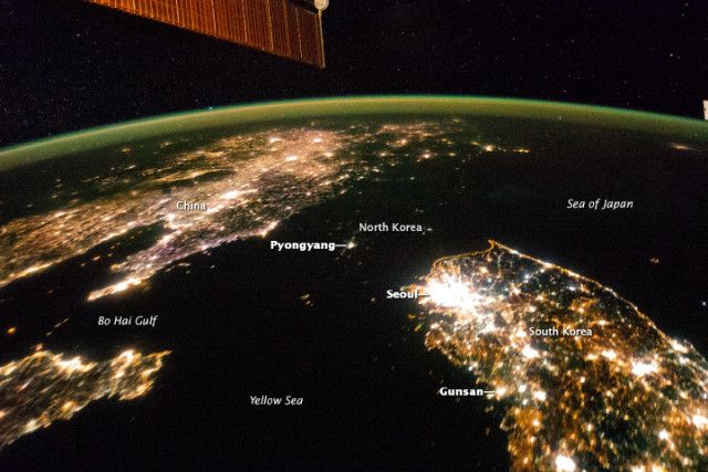 "North Korea seen from space reveals a country living in the dark : io9.com ""Astronauts aboard the ISS recently captured a rather revealing night image of East Asia. Though the dark patch at center looks like water, it's actually North Korea — a country of 25 million people sandwiched between China and South Korea."""