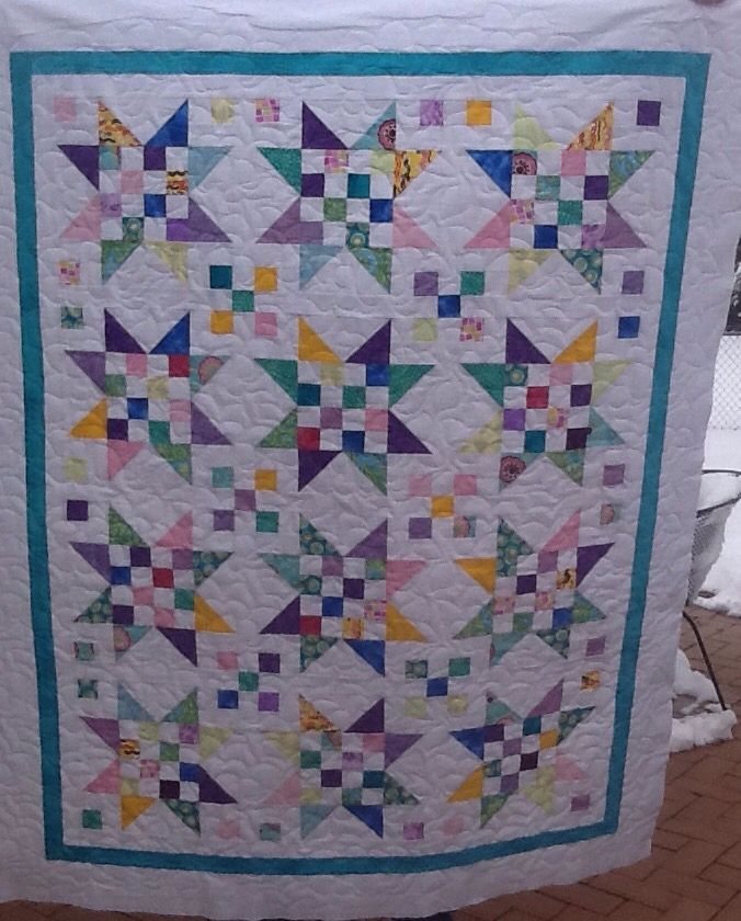 Scrappy stars in the snow quilt
