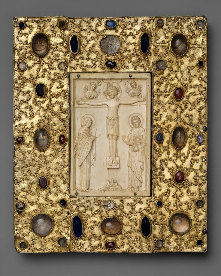 Book Cover with Byzantine Icon of the Crucifixion Date: 1000 (ivory); before 1085 (setting) Geography: Made in Constantinople (Ivory); Made in Jaca, Spain (Setting) Culture: Byzantine (ivory); Spanish (setting) Medium: Silver-gilt with pseudo-filigree, glass, crystal, and sapphire cabochons, Ivory on wood support Dimensions: Overall: 10 3/8 x 8 5/8 x 1 in. (26.4 x 21.9 x 2.5 cm)