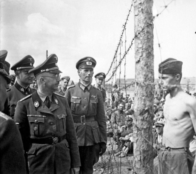 "(from ""The 32 most powerful images ever taken"" article) Prisoner stares with no fear at Heinrich Himmler, one of the chief architects of the holocaust and chief of the gestapo. Photo credits: unknown"