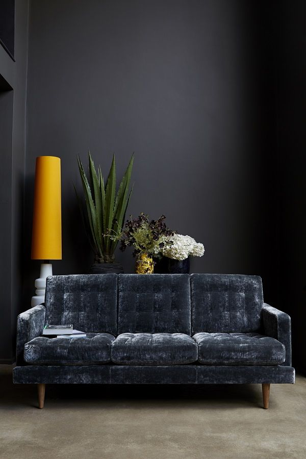 """The Abigail sofa, """"I wanted this to be a forever piece. It's the perfect place to sip a martini, kick back to watch a film, or just hang out with the family."""""""