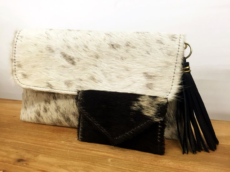 Hide clutch with matching wallet. Find yours now at Millworks Santa Barbara!