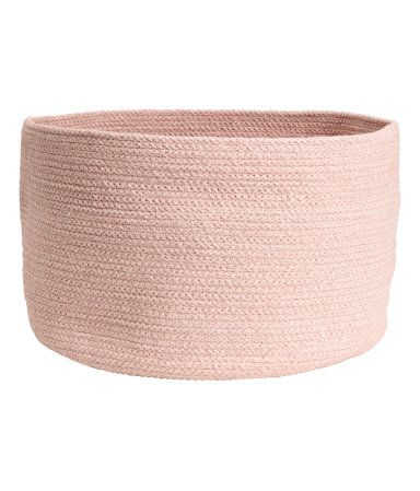 Dusky pink. Storage basket in thick melange cotton fabric. Height 8 3/4 in., diameter 13 3/4 in.